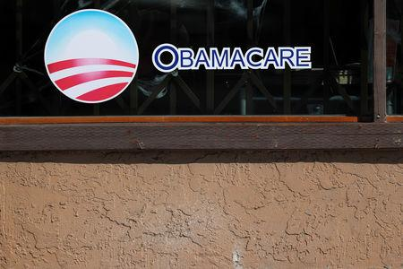 A sign on an insurance store advertises Obamacare in San Ysidro