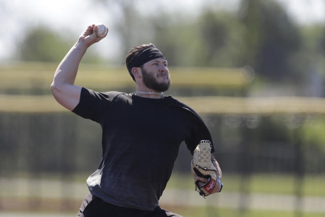 Professional baseball player Nolan Watson throws during a workout at Grand Park, Friday, June 12, 2020, in Westfield, Ind. Professional and college players gathered for a workout with proceeds from the event will go to Reviving Baseball in the Inner City of Indianapolis. (AP Photo/Darron Cummings)