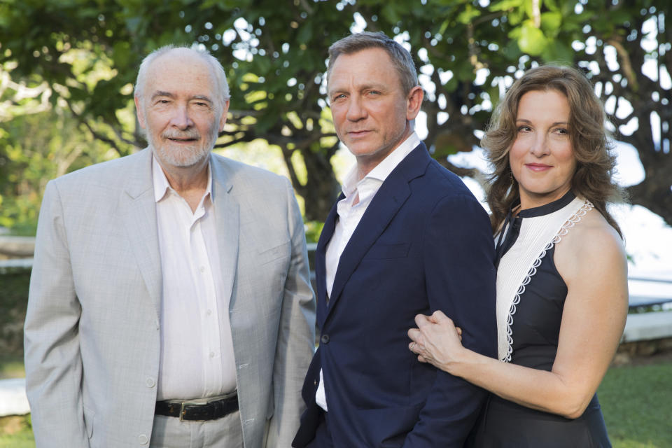 Producers Michael G Wilson, left, and Barbara Broccoli, right, pose for photographers with actor Daniel Craig during the photo call of the latest installment of the James Bond film franchise, currently known as 'Bond 25', in Oracabessa, Jamaica, Thursday, April 25, 2019. (AP Photo/Leo Hudson)