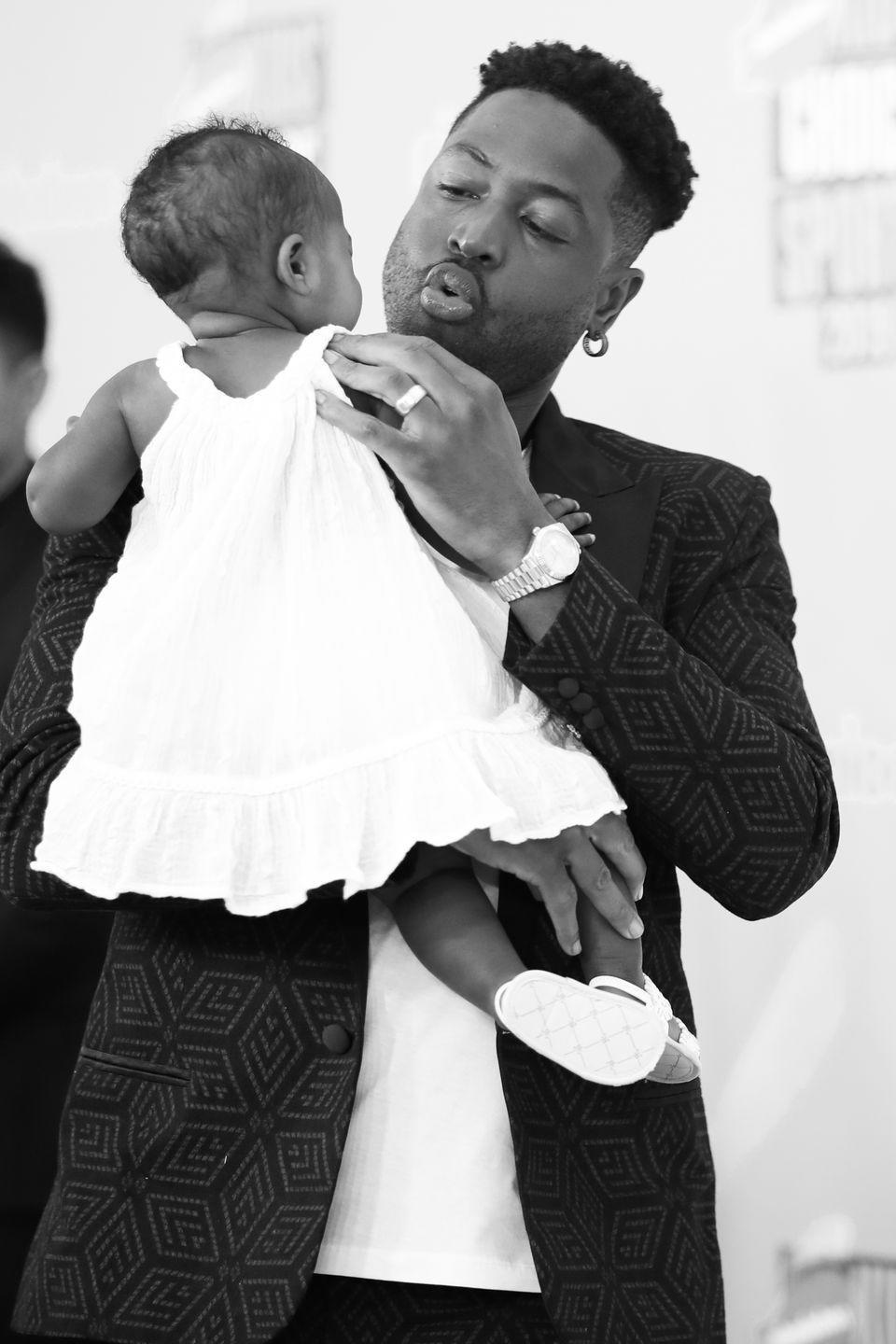 """<p><strong>Children</strong>: Zaire Blessing Dwyane Wade (18), Dahveon Morris (Wade's nephew who he has custody of, 18), <a href=""""https://www.oprahmag.com/entertainment/a31280556/dwyane-wade-gabrielle-union-daughter-zaya-red-carpet-debut/"""" rel=""""nofollow noopener"""" target=""""_blank"""" data-ylk=""""slk:Zaya Wade"""" class=""""link rapid-noclick-resp"""">Zaya Wade</a> (13), Xavier Zechariah Wade (6), <a href=""""https://www.oprahmag.com/entertainment/a29729449/gabrielle-union-kaavia-james-first-birthday-video-montage/"""" rel=""""nofollow noopener"""" target=""""_blank"""" data-ylk=""""slk:Kaavia James Union Wade"""" class=""""link rapid-noclick-resp"""">Kaavia James Union Wade</a> (1)</p><p>The former NBA star is busy raising <a href=""""https://www.oprahmag.com/entertainment/a29536479/gabrielle-union-dwyane-wade-kids/"""" rel=""""nofollow noopener"""" target=""""_blank"""" data-ylk=""""slk:4 biological children along with his nephew Dahveon"""" class=""""link rapid-noclick-resp"""">4 biological children along with his nephew Dahveon</a>, who he has custody of. He welcomed <a href=""""https://www.oprahmag.com/entertainment/a25238335/gabrielle-union-dwyane-wade-baby-oprah-photo/"""" rel=""""nofollow noopener"""" target=""""_blank"""" data-ylk=""""slk:his youngest, Kaavia James"""" class=""""link rapid-noclick-resp"""">his youngest, Kaavia James</a>, in 2018 with longtime partner <a href=""""https://www.oprahmag.com/life/relationships-love/a25444336/gabrielle-union-dwyane-wade-oprah-interview/"""" rel=""""nofollow noopener"""" target=""""_blank"""" data-ylk=""""slk:Gabrielle Union"""" class=""""link rapid-noclick-resp"""">Gabrielle Union</a>, who he <a href=""""https://www.oprahmag.com/entertainment/a27407112/gabrielle-union-and-dwyane-wade-marriage/"""" rel=""""nofollow noopener"""" target=""""_blank"""" data-ylk=""""slk:married in 2014"""" class=""""link rapid-noclick-resp"""">married in 2014</a>. In 2011, <a href=""""https://www.espn.com/blog/truehoop/miamiheat/post/_/id/9472/an-interview-with-dwyane-wade"""" rel=""""nofollow noopener"""" target=""""_blank"""" data-ylk=""""slk:he told ESPN"""" class=""""link rapid-noclick-resp"""">he told ESPN</a>, """"I love bei"""