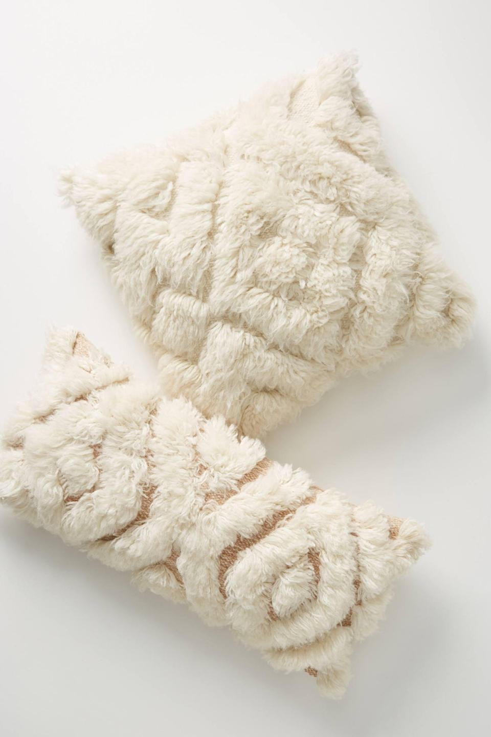 """<p>This soft and fluffy <a href=""""https://www.popsugar.com/buy/Joanna-Gaines-Anthropologie-Wool-Camille-Pillow-559555?p_name=Joanna%20Gaines%20for%20Anthropologie%20Wool%20Camille%20Pillow&retailer=anthropologie.com&pid=559555&price=118&evar1=casa%3Aus&evar9=46598422&evar98=https%3A%2F%2Fwww.popsugar.com%2Fhome%2Fphoto-gallery%2F46598422%2Fimage%2F47342387%2FJoanna-Gaines-for-Anthropologie-Wool-Camille-Pillow&list1=shopping%2Chome%20decor%2Chome%20shopping&prop13=mobile&pdata=1"""" class=""""link rapid-noclick-resp"""" rel=""""nofollow noopener"""" target=""""_blank"""" data-ylk=""""slk:Joanna Gaines for Anthropologie Wool Camille Pillow"""">Joanna Gaines for Anthropologie Wool Camille Pillow</a> ($118) is what your sofa needs.</p>"""