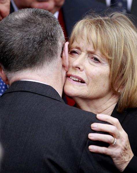 Marie Heaney is comforted during the funeral of her husband, Irish poet Seamus Heaney at the Church of the Sacred Heart in Donnybrook, Dublin, Ireland, Monday, Sept. 2, 2013. Ireland mourned the loss of its Nobel laureate poet, Seamus Heaney, with equal measures of poetry and pain Monday in a funeral full of grace notes and a final message from the great man himself: Don't be afraid. Among those packing the pews of Dublin's Catholic Church of the Sacred Heart were government leaders from both parts of Ireland, poets and novelists, Bono and The Edge from rock band U2, and former Lebanese hostage Brian Keenan. Heaney won the Nobel Prize for literature in 1995 in recognition of his wide-ranging writings inspired by the rural wonders of Ireland, the strife of his native Northern Ireland, the ancient cultures of Europe, of Catholic faith and Celtic mysticism, and the immutability of family ties. He died Friday in a Dublin hospital at the age of 74. (AP Photo/Peter Morrison)