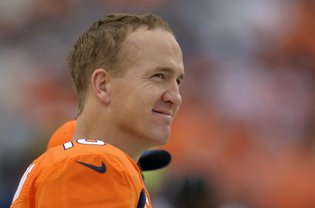 FILE - In this Sept. 29, 2013 file photo, Denver Broncos quarterback Peyton Manning watches play from the sidelines against the Philadelphia Eagles in the fourth quarter an NFL football game, in Denver. Manning returns to Indianapolis on Sunday, Oct. 20, 2013, a better quarterback than the one who left. (AP Photo/Jack Dempsey, File)