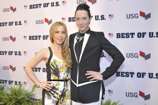 WASHINGTON, DC - APRIL 02: Tara Lipinski and Johnny Weir walk the red carpet during the U.S. Olympic Committee's Best of U.S. Awards at Warner Theatre on April 2, 2014 in Washington, DC. (Photo by Kris Connor/Getty Images for the USOC)