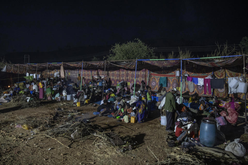 Tigray people who fled the conflict in Ethiopia's Tigray region, gather in their shelters at Umm Rakouba refugee camp in Qadarif, eastern Sudan, Thursday, Nov. 26, 2020. Ethiopia's prime minister said Thursday the army has been ordered to move on the embattled Tigray regional capital after his 72-hour ultimatum ended for Tigray leaders to surrender, and he warned the city's half-million residents to stay indoors and disarm. (AP Photo/Nariman El-Mofty)