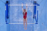 Angelina Melnikova, of Russian Olympic Committee, performs on the uneven bars during women's artistic gymnastic qualifications at the 2020 Summer Olympics, Sunday, July 25, 2021, in Tokyo. (AP Photo/Morry Gash)