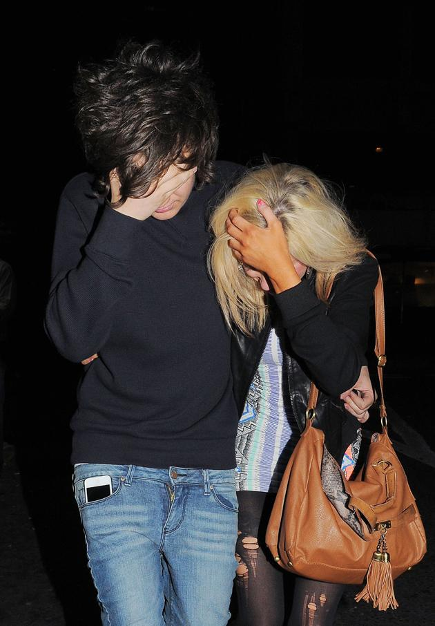 Celebrity photos: Frankie Cocozza is never normally one to shy away from the cameras, however as he left a London club with a mystery blonde girl, he hid his face from the paps. Aw, why so shy Frankie?