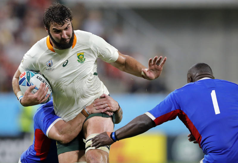 South Africa's Lood de Jager runs at Namibia's Desiderius Sethie, right, during the Rugby World Cup Pool B game at the City of Toyota Stadium between South Africa and Namibia in Toyota City, Japan, Saturday, Sept. 28, 2019. (AP Photo/Christophe Ena)