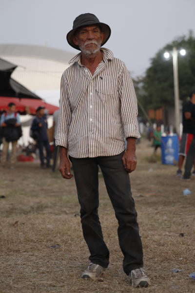 Candido de Jesus Pineda, a 62-year-old Honduran migrant, poses for a portrait at a temporary shelter set up by authorities for migrants arriving to Tecun Uman, Guatemala on the border with Mexico, Tuesday, Jan. 21, 2020. Jesus Pineda said he left behind two teenage daughters in Honduras and that his trek by foot was a better option than staying at home in a difficult economic situation. (AP Photo/Moises Castillo)