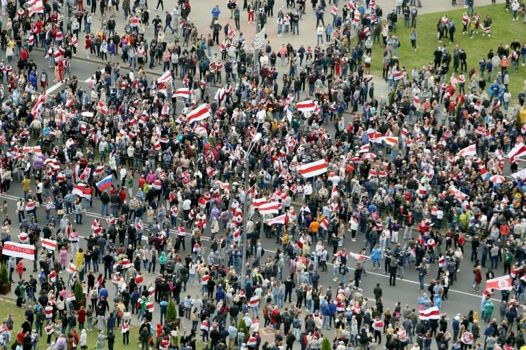 Tens of thousands march in Belarus despite police detentions
