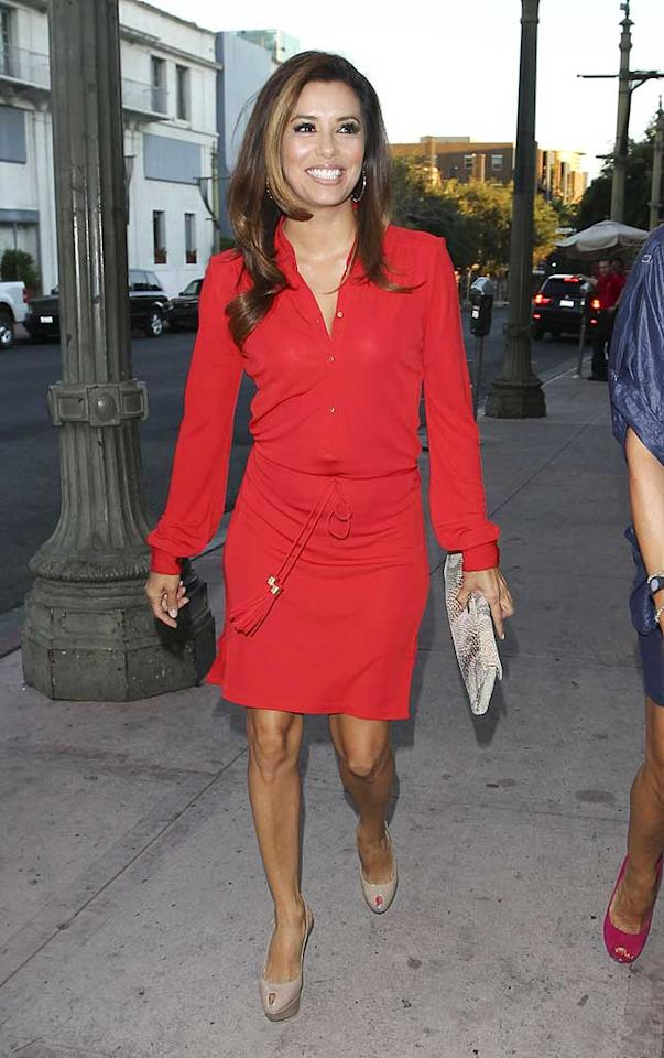"""Call me crazy, but it seems like Eva Longoria has been all smiles since her split with philandering Spurs player Tony Parker. The """"Desperate Housewives"""" hottie flashed her pearly whites once again while rocking a a vibrant red shirt dress and nude Louboutins to dinner at her restaurant, Beso, in Hollywood. Hellmuth Dominguez/<a href=""""http://www.pacificcoastnews.com/"""" target=""""new"""">PacificCoastNews.com</a> - August 25, 2011"""