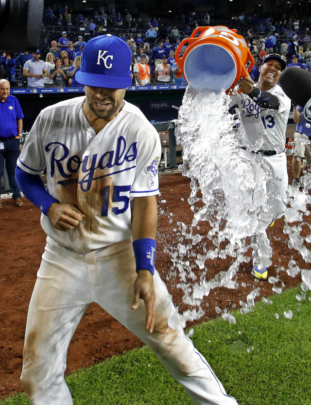 Kansas City Royals' Whit Merrifield (15) is doused by Salvador Perez (13) after their baseball game against the Chicago White Sox Tuesday, Sept. 11, 2018, in Kansas City, Mo. The Royals won 6-3. (AP Photo/Charlie Riedel)