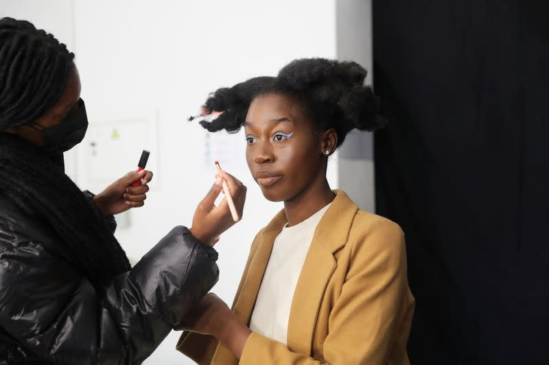 Lehlogonolo Machaba, the first openly transgender woman to compete for the Miss South Africa title has her makeup done before a photo shoot in Johannesburg