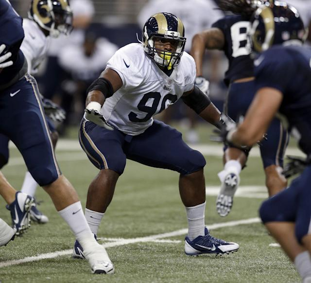 St. Louis Rams defensive end Michael Sam participates in a drill during NFL football training camp at Edward Jones Dome Saturday, Aug. 2, 2014, in St. Louis. (AP Photo/Jeff Roberson)