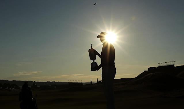 Jordan Spieth holds up the trophy after winning the U.S. Open golf tournament at Chambers Bay on Sunday, June 21, 2015 in University Place, Wash. (AP Photo/Charlie Riedel)