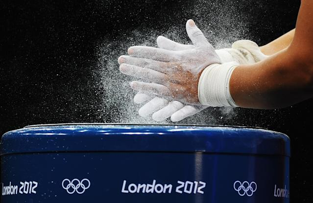 LONDON, ENGLAND - JULY 31: Silvana Saldarriaga of Peru chalks her hands prior to competing in the Women's 63kg Weightlifting final on Day 4 of the London 2012 Olympic Games at ExCeL on July 31, 2012 in London, England. (Photo by Laurence Griffiths/Getty Images)