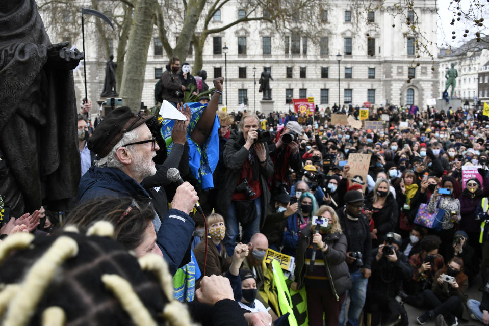 Former Labour party leader Jeremy Corbyn, at left, addresses demonstrators during a 'Kill the Bill' protest in London, Saturday, April 3, 2021. The demonstration is against the contentious Police, Crime, Sentencing and Courts Bill, which is currently going through Parliament and would give police stronger powers to restrict protests. (AP Photo/Alberto Pezzali)