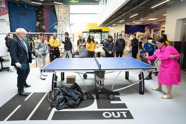 Prime Minister Boris Johnson plays table tennis with Home Secretary Priti Patel during a visit to the HideOut Youth Zone in Manchester