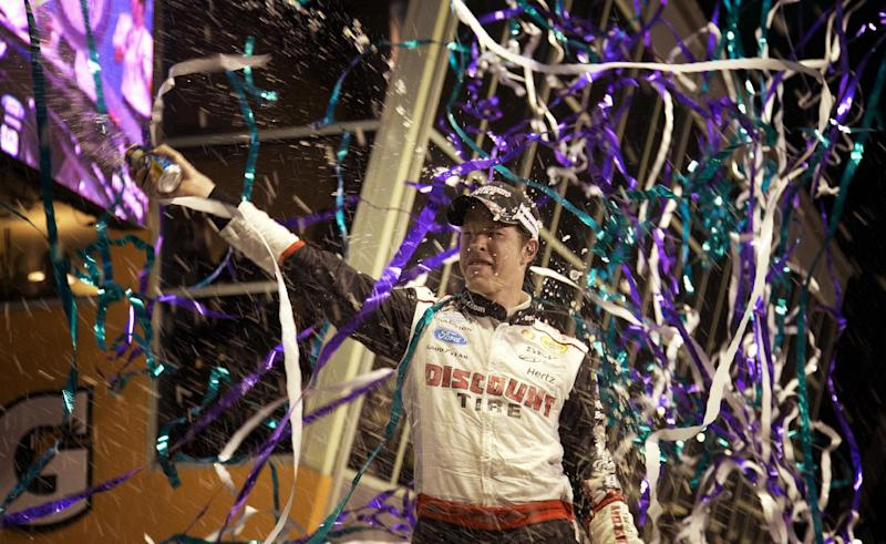 Brad Keselowski celebrates after winning the NASCAR Nationwide Series auto race at Homestead-Miami Speedway in Homestead, Fla., Saturday, Nov. 16, 2013. (AP Photo/J Pat Carter)