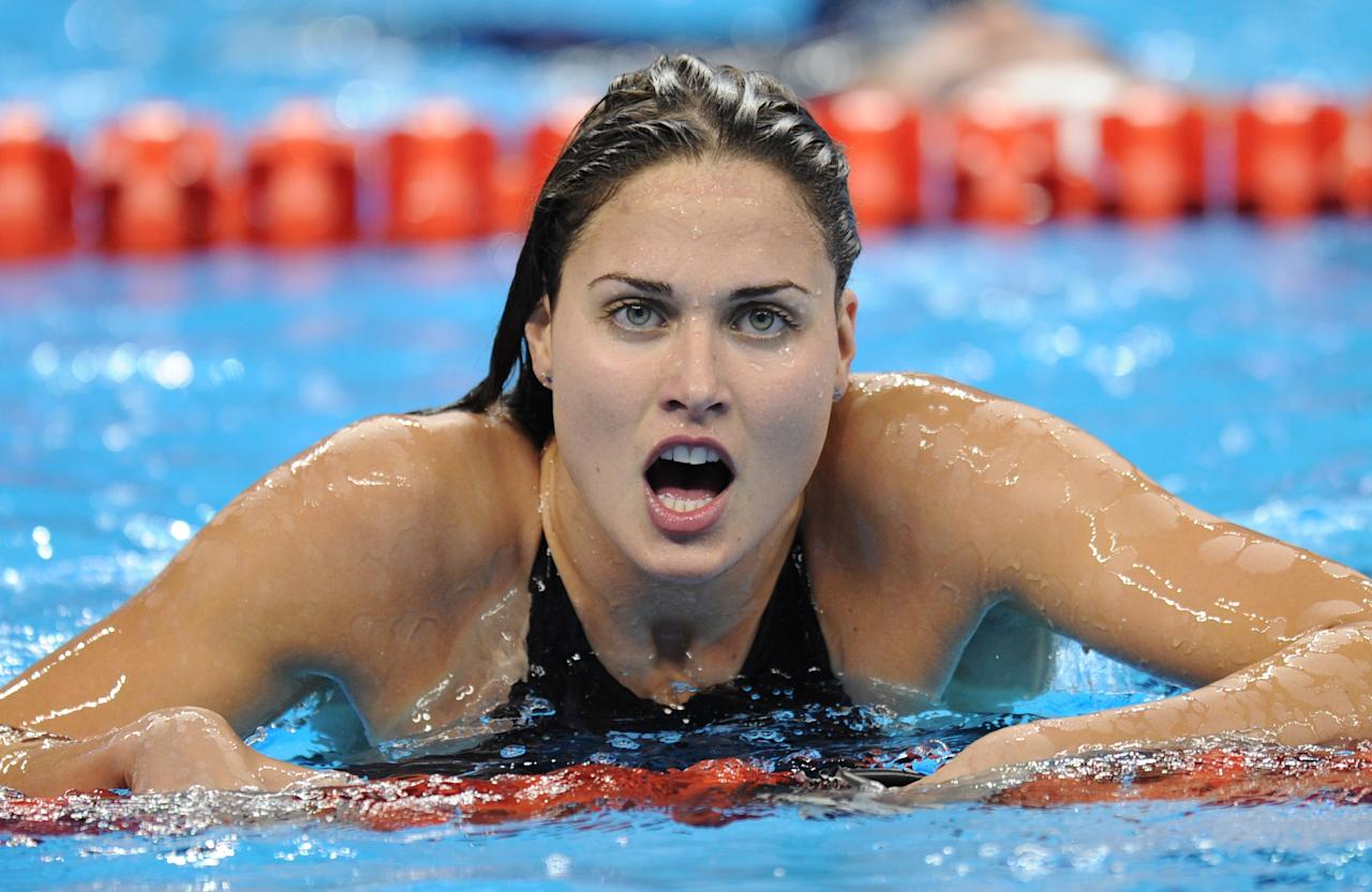 Hungary's Zsuzsanna Jakabos reacts after she competed in the semi-finals of the women's 200-metre butterfly swimming event in the FINA World Championships at the indoor stadium of the Oriental Sports Center in Shanghai on July 27, 2011.  AFP PHOTO / FRANCOIS XAVIER MARIT (Photo credit should read FRANCOIS XAVIER MARIT/AFP/Getty Images)