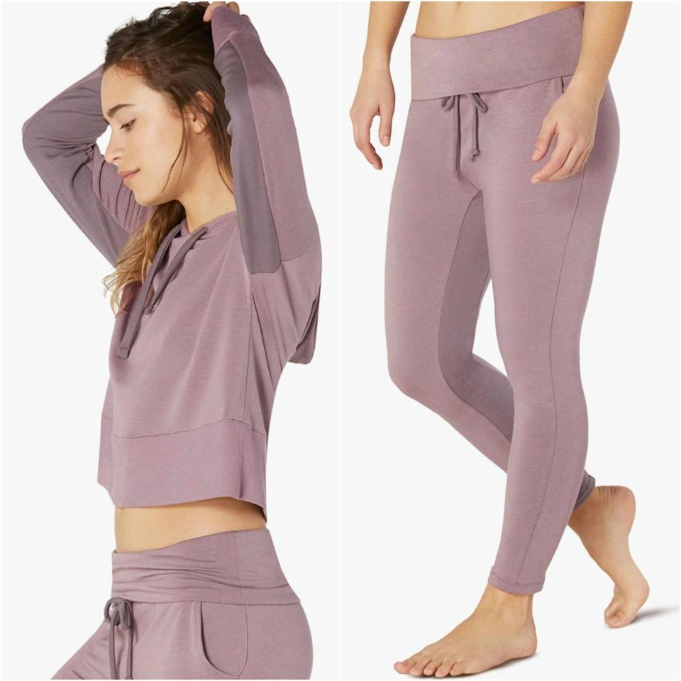 """<p>The <a href=""""https://www.beyondyoga.com/studio-to-street/so-cozy-shop/tonal-block-cropped-hoodie.html?color=dusty-mauve"""" rel=""""nofollow"""">hoodie half</a> of this set is super cute, but it's the bottoms we're completely obsessed with. Called the Foldover Midi Swegging — a portmanteau of sweatpants and leggings — they're made with a modal-blend fleece so comfortable that you'll wonder how you ever truly lounged before these hybrid pants entered your life.</p> <p><strong>$209 for both</strong> (<a href=""""https://www.beyondyoga.com/tonal-block-foldover-midi-swegging.html"""" rel=""""nofollow"""">Shop Now</a>)</p>"""