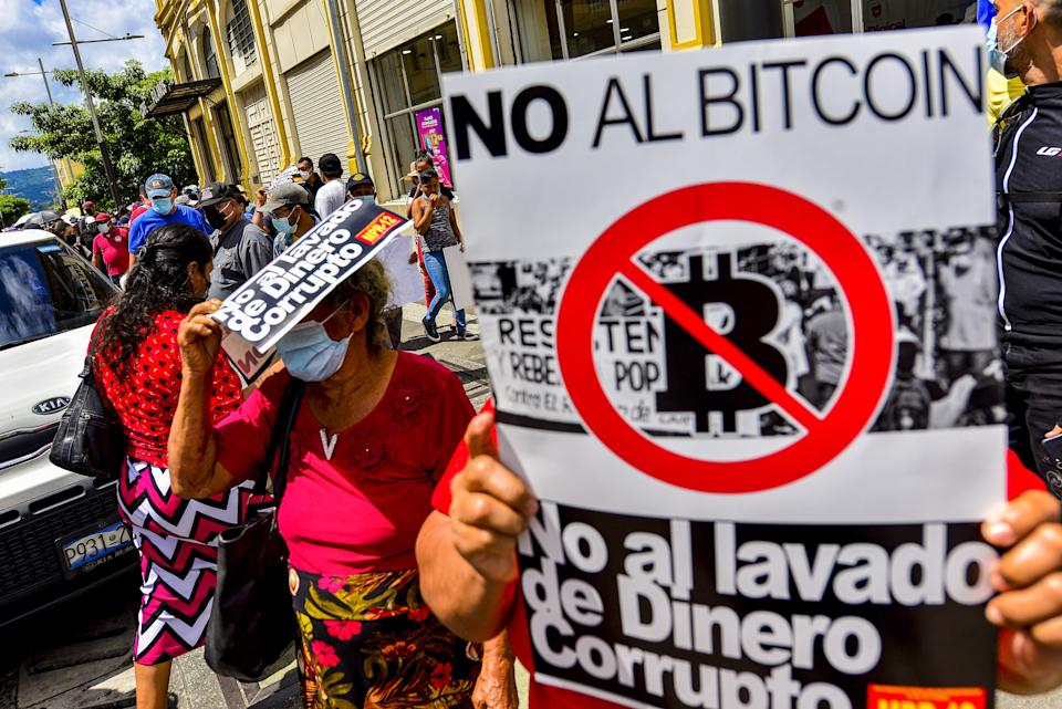 SAN SALVADOR, EL SALVADOR - 2021/09/15: A placard against the government's Bitcoin law, during the protest. Thousands of Salvadorans took to the streets on El Salvador's Bicentennial Independence Day against El Salvador's President Nayib Bukele and his government's policies. (Photo by Camilo Freedman/SOPA Images/LightRocket via Getty Images)