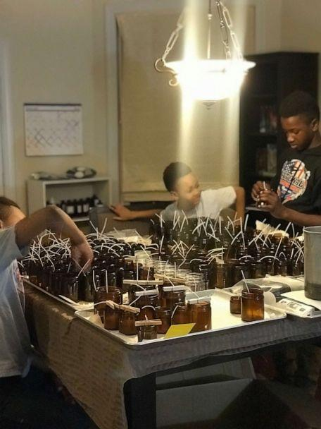 PHOTO: The Gill brothers prepare candles to make for their business Frères Branchiaux. (Celena Gill)