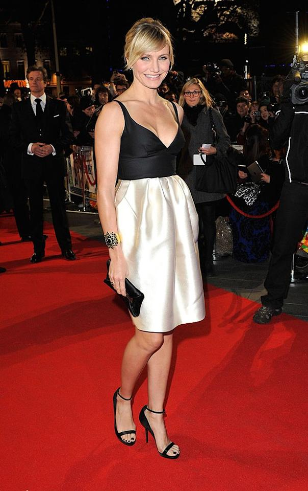 """We're on the fence with this one and would love to know your thoughts. Cameron Diaz's hair, Tom Binns cuff, and black toenail polish were all on-point, but what about this Stella McCartney cocktail frock she wore to the Euro debut of """"Gambit""""? The plunging top fits like a glove, but the skirt portion seems a bit billowy (aka unflattering). Discuss! (11/7/2012)"""