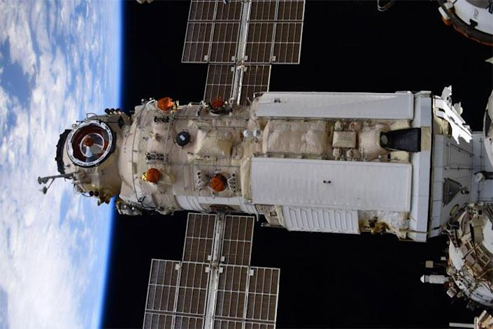 The Russian Nauka multi-purpose laboratory module, seen here, docked at the International Space Station early Thursday. A software error caused unexpected thruster firings later, when the module was out of direct contact with Russian flight controllers, which briefly knocked the station out of its normal orientation. / Credit: Oleg Novitskiy/Twitter