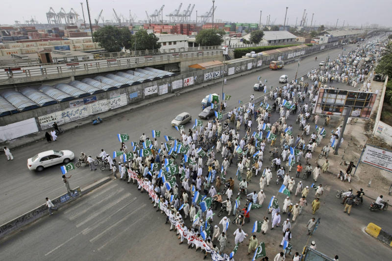 Supporters of Pakistani religious party Jamaat-e-Islami attend a rally condemning the movement of NATO supplies to Afghanistan through Pakistan, in Karachi, Pakistan, Sunday, July 15, 2012. (AP Photo/Fareed Khan)