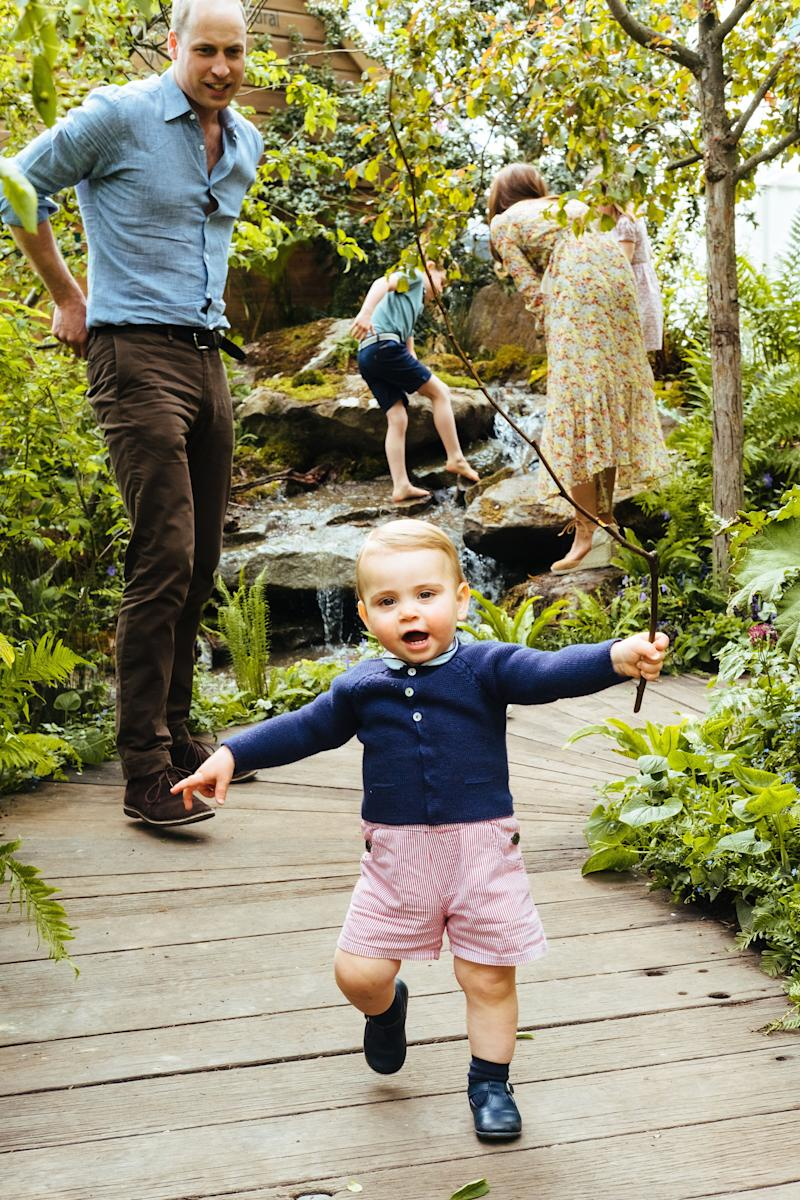 Louis runs towards the camera as William looks on, while Kate, George and Louis play in the babbling brook [Photo: Matt Porteous]