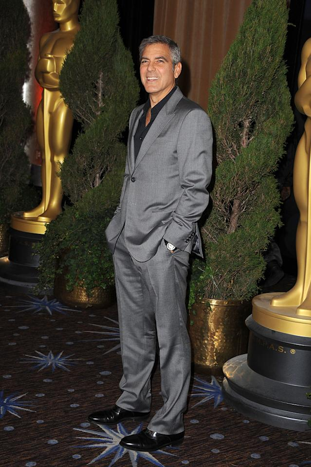 "Best Actor front runner George Clooney (""The Descendants"") looked dapper, yet a bit lost, in his baggy gray suit."
