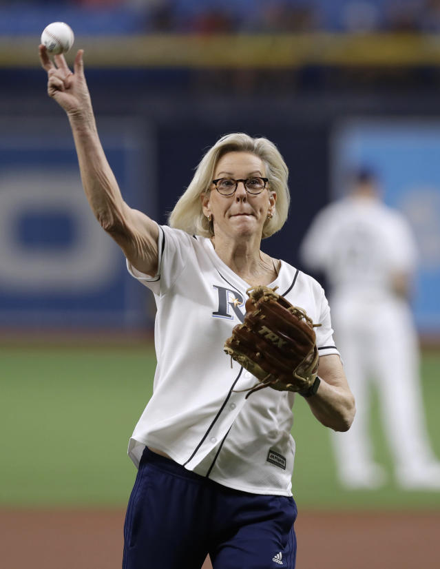 Tampa, Fla., Mayor Jane Castor throws out the ceremonial first pitch before a baseball game between the Tampa Bay Rays and the Los Angeles Angels on Friday, June 14, 2019, in St. Petersburg, Fla. Castor is Tampa's first LGBTQ mayor. The Rays were celebrating Pride Night. (AP Photo/Chris O'Meara)