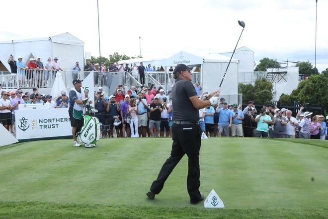 Phil Mickelson draws a crowd as he tees off on 15 during the opening round of the Northern Trust Golf Tournament part of the PGA Tour being played at Liberty National Golf Club in Jersey City on August 19, 2021.