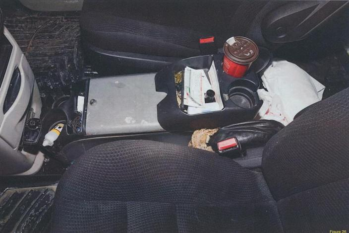 <p>The fur-lined hat police found in McArthur's 2017 Dodge Caravan, matching the hat worn by several of McArthur's victims in staged photos he took of them in the course of murdering them. In this photo, the hat is stuffed into the centre console of the van. (Photo provided by the Crown) </p>