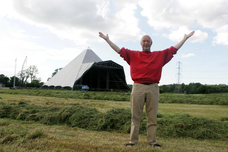 Behind the scenes at Glastonbury Festival with Michael and Emily Eavis in 2005  (Photo by Andy Willsher/Redferns/Getty Images)