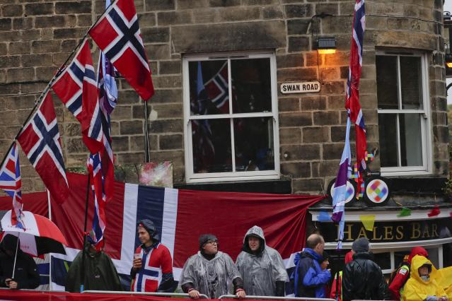 Spectators follow the men elite race, at the road cycling World Championships in Harrogate, England, Sunday, Sept. 29, 2019. (AP Photo/Manu Fernandez)