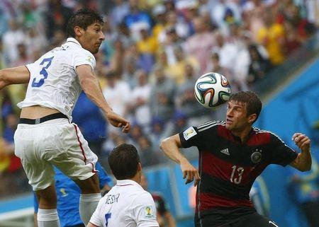 Omar Gonzalez of the U.S.(3) jumps for the ball with Germany's Thomas Mueller (R) during their 2014 World Cup Group G soccer match at the Pernambuco arena in Recife June 26, 2014. REUTERS/Tony Gentile