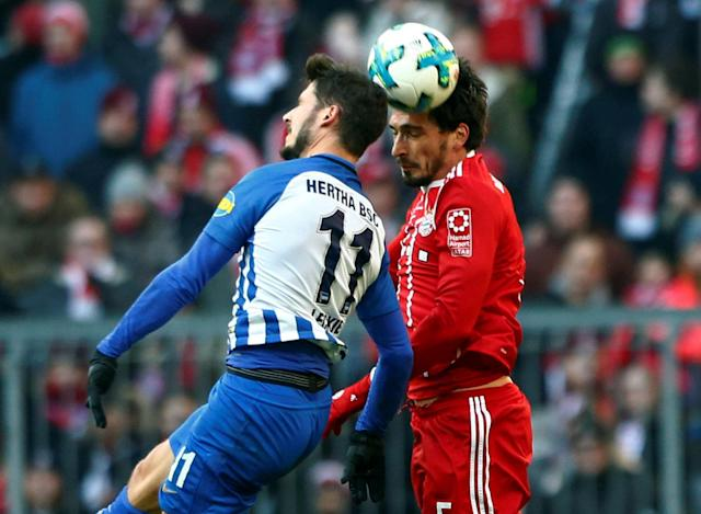 Soccer Football - Bundesliga - Bayern Munich vs Hertha BSC - Allianz Arena, Munich, Germany - February 24, 2018 Hertha Berlin's Mathew Leckie in action with Bayern Munich's Mats Hummels REUTERS/Michaela Rehle DFL RULES TO LIMIT THE ONLINE USAGE DURING MATCH TIME TO 15 PICTURES PER GAME. IMAGE SEQUENCES TO SIMULATE VIDEO IS NOT ALLOWED AT ANY TIME. FOR FURTHER QUERIES PLEASE CONTACT DFL DIRECTLY AT + 49 69 650050