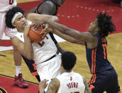 Rutgers guard Ron Harper Jr. (24) pulls down a rebound away from Illinois guard Ayo Dosunmu (11) during the second half of an NCAA college basketball game Sunday, Dec. 20, 2020, in Piscataway, N.J. (AP Photo/Bill Kostroun)