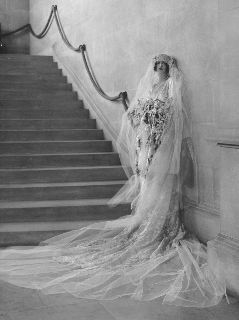 """<p>Heiress Cornelia Venderbilt's 1924 wedding to British diplomat John Cecil was <em>the</em> party of the century, and took place at the family's famous Biltmore estate in Asheville. A whopping 2,500 people attended the reception. </p><p>""""The bride was lovely in a gown of white satin, very straight, with long sleeves,"""" <a href=""""http://gardenandgun.com/articles/a-legendary-southern-wedding/"""" rel=""""nofollow noopener"""" target=""""_blank"""" data-ylk=""""slk:wrote"""" class=""""link rapid-noclick-resp"""">wrote</a> the <em>Asheville Citizen</em>. """"Her bridal veil of tulle and lace, which she wore over her face when entering the church, was four yards long. It was caught with orange blossoms from Florida...Her bridal bouquet was of orchids and lilies of the valley, made in Asheville by the Middlemount Gardens. Each of her satin slippers was ornamented with a single orange blossom."""" </p>"""