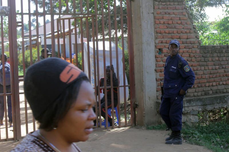 A policeman guards a hospital in Butembo, Congo, on Saturday, April 20, 2019, after militia members attacked an Ebola treatment center in the city's Katwa district overnight. Violence has deeply complicated efforts to contain what has become the second-deadliest Ebola virus outbreak in history. (AP Photo/Al-Hadji Kudra Maliro)
