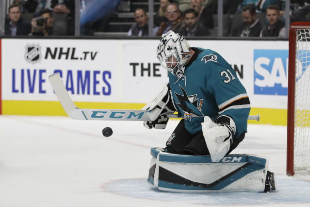 San Jose Sharks' Martin Jones blocks a shot from the Carolina Hurricanes during the second period of an NHL hockey game Wednesday, Oct. 16, 2019, in San Jose, Calif. (AP Photo/Ben Margot)