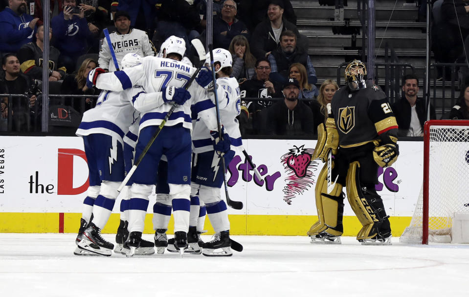 Tampa Bay Lightning players celebrate after forward Steven Stamkos, left, scored on Vegas Golden Knights goalie Marc-Andre Fleury (29) during the second period of an NHL hockey game Thursday, Feb. 20, 2020, in Las Vegas. (AP Photo/Isaac Brekken)