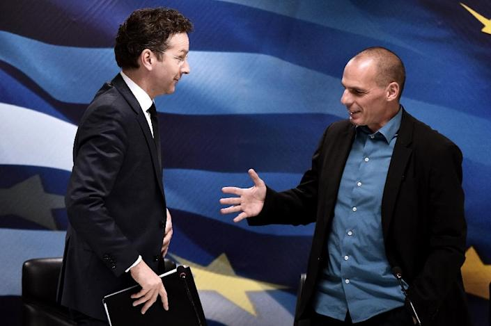 """Jeroen Dijsselbloem (left) says reform proposals by Yannis Varoufakis (right) are """"far from complete"""" (AFP Photo/Aris Messinis)"""