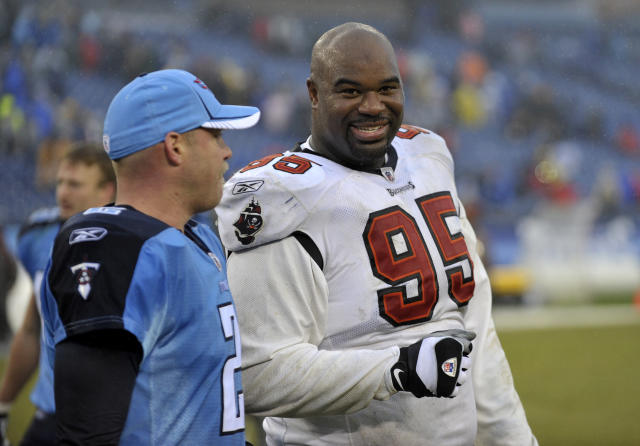 FILE - In this Sunday, Nov. 27, 2011 file photo, Tampa Bay Buccaneers defensive tackle Albert Haynesworth (95) talks with former teammate Tennessee Titans kicker Rob Bironas (2) after an NFL football game in Nashville, Tenn. Former Tennessee Titans All-Pro defenseman Albert Haynesworth says on social media that he needs a kidney transplant. He shared a photo of himself in a hospital bed and wrote that his kidney failed him on Sunday, July 7, 2019 and hes looking for a donor.(AP Photo/Joe Howell, File)