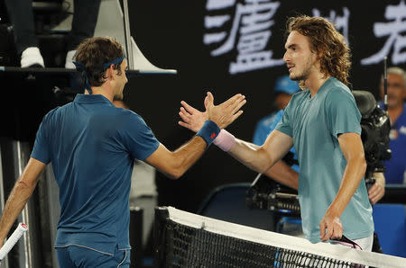 Tennis - Australian Open - Fourth Round - Melbourne Park, Melbourne, Australia, January 20, 2019. Switzerland's Roger Federer and Greece's Stefanos Tsitsipas greet each other after the match. REUTERS/Adnan Abidi