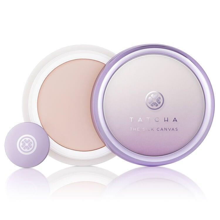 """<p>""""The <span>Tatcha The Silk Canvas Protective Primer</span> ($52) is quite unique; it comes in a pot instead of a bottle. The formula is a thick, balm-like consistency and you use a small disk to scrape your desired amount out of the pot. What first captured my attention was the incredible scent - the floral notes are pretty enough to be a perfume. The velvety consistency melts into your face the moment you apply it; it's hydrating and sleek without feeling greasy. Even before I apply my foundation, I can see a huge improvement in my complexion."""" - MW </p>"""