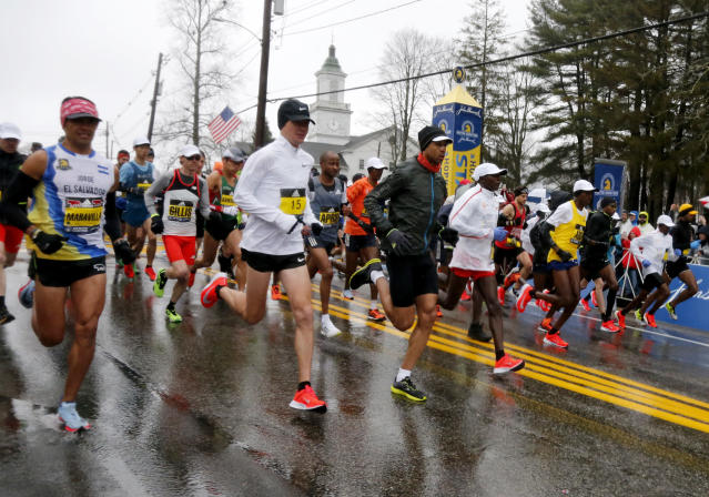 The elite men runners break from the starting line during the 122nd running of the Boston Marathon in Hopkinton, Mass., Monday, April 16, 2018. (AP Photo/Mary Schwalm)