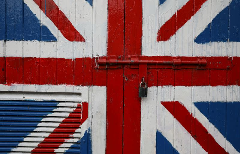 A padlock is seen on a door covered with a Union Jack mural on the Fountain Estate in Londonderry, Northern Ireland
